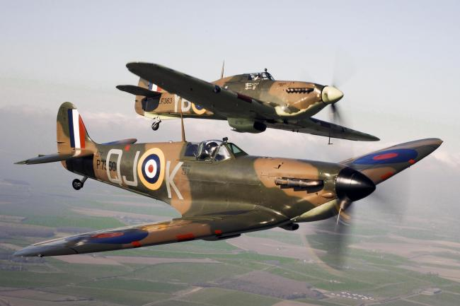 Ministry of Defence handout photo dated 13/4/2010 of a Spitfire P7350 (front) flying alongside Hurricane LF363 (back) from the Battle of Britain Memorial Flight, over RAF Conningsby. Veterans, military figures, politicians and other dignitaries will gathe