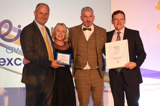 Local publicans Phil Hoyle and fiancée Sarah receiving their award with Ei Group's Executive Simon Townsend