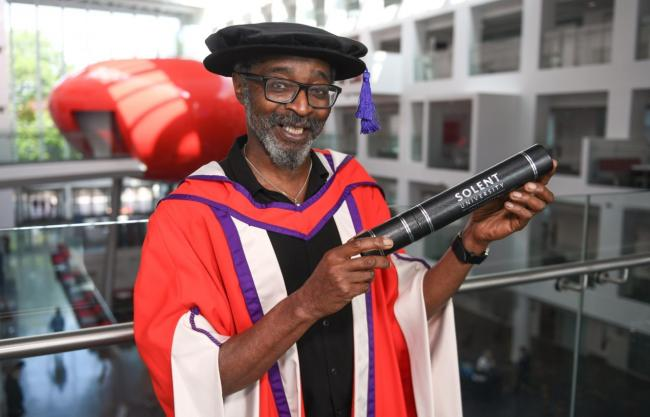 Don John receiving his honourary degree