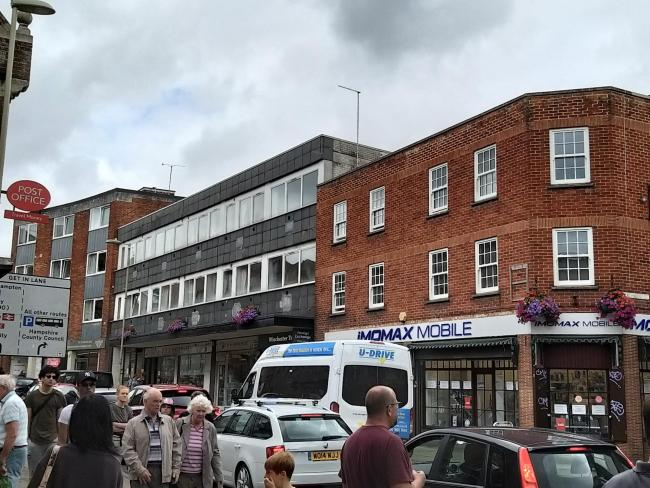 The planned new storey for flats would go above the D&G Hardware store in St George's Street, Winchester (centre, grey building).