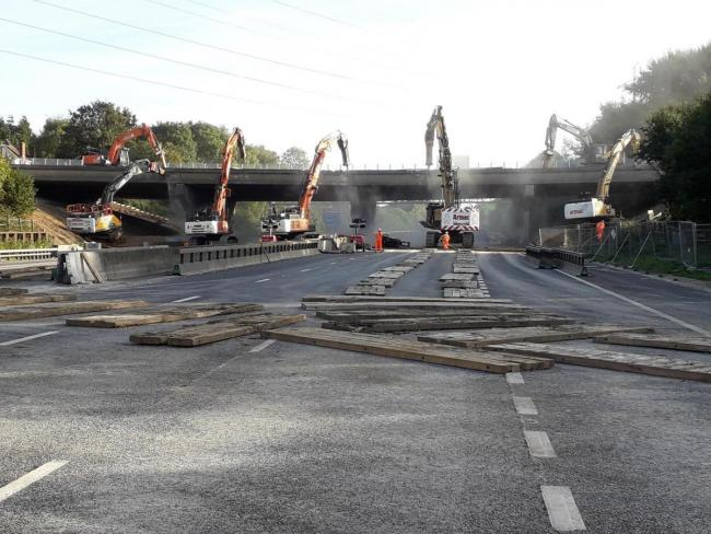 Work continuing on the demolition of the western part of the Romsey Road bridge over the M27 in Hampshire
