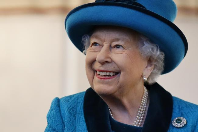 Queen Elizabeth II during a visit to the new headquarters of the Royal Philatelic society in London..