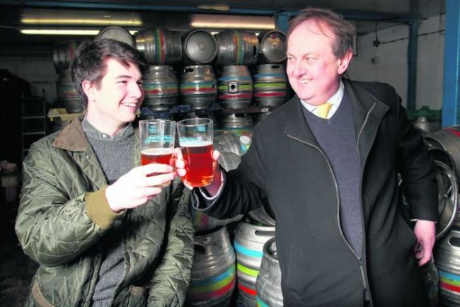 Simon Brown, right, toasts success with his godson Dugald Rhodes.