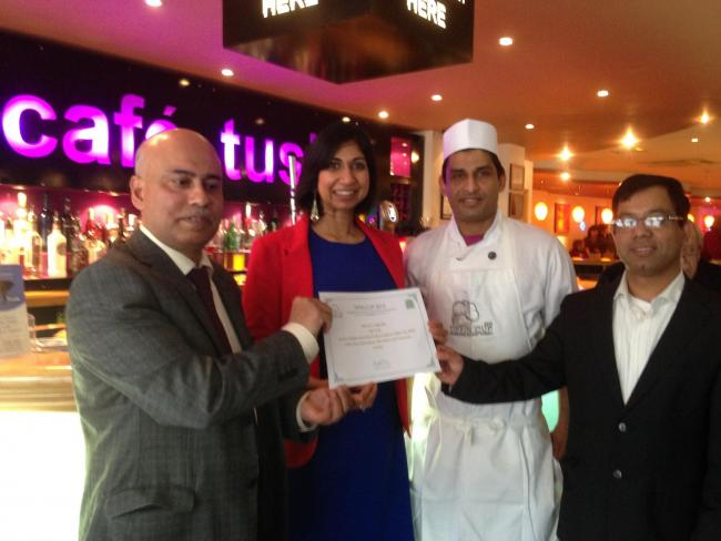 MP Suella Fernandes presents the Café Tusk team with their award