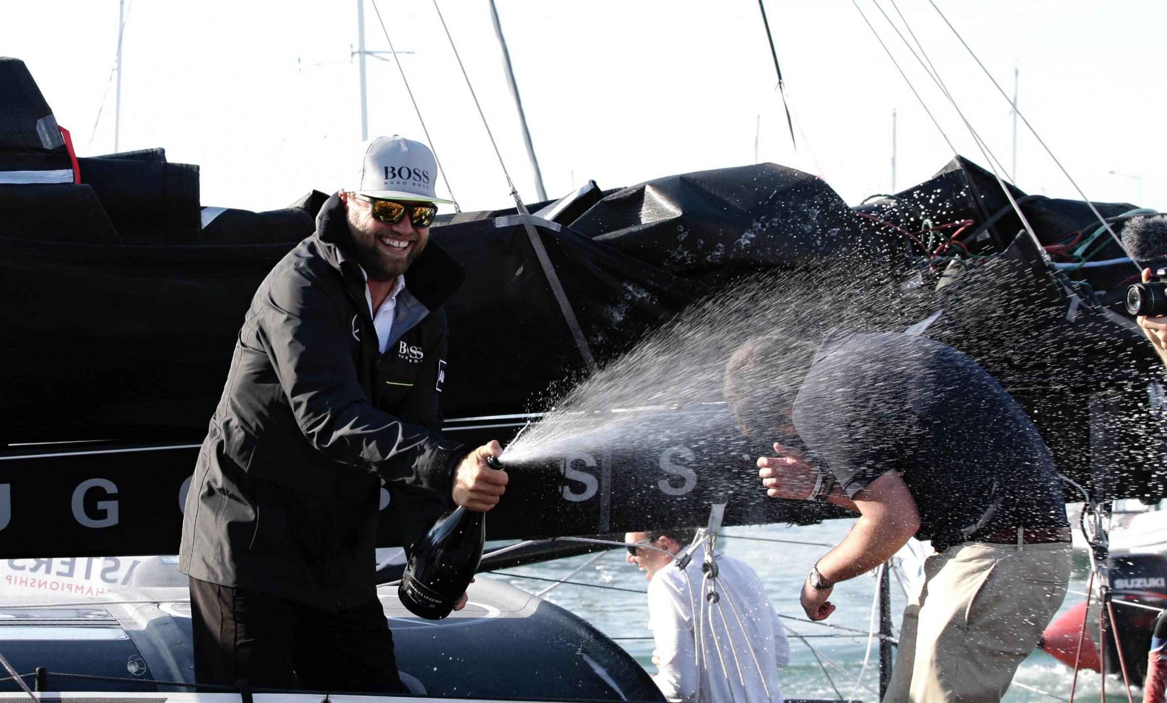 Champagne moment for Alex Thomson. Photo: Alex Thomson Racing/Thierry Martinez.