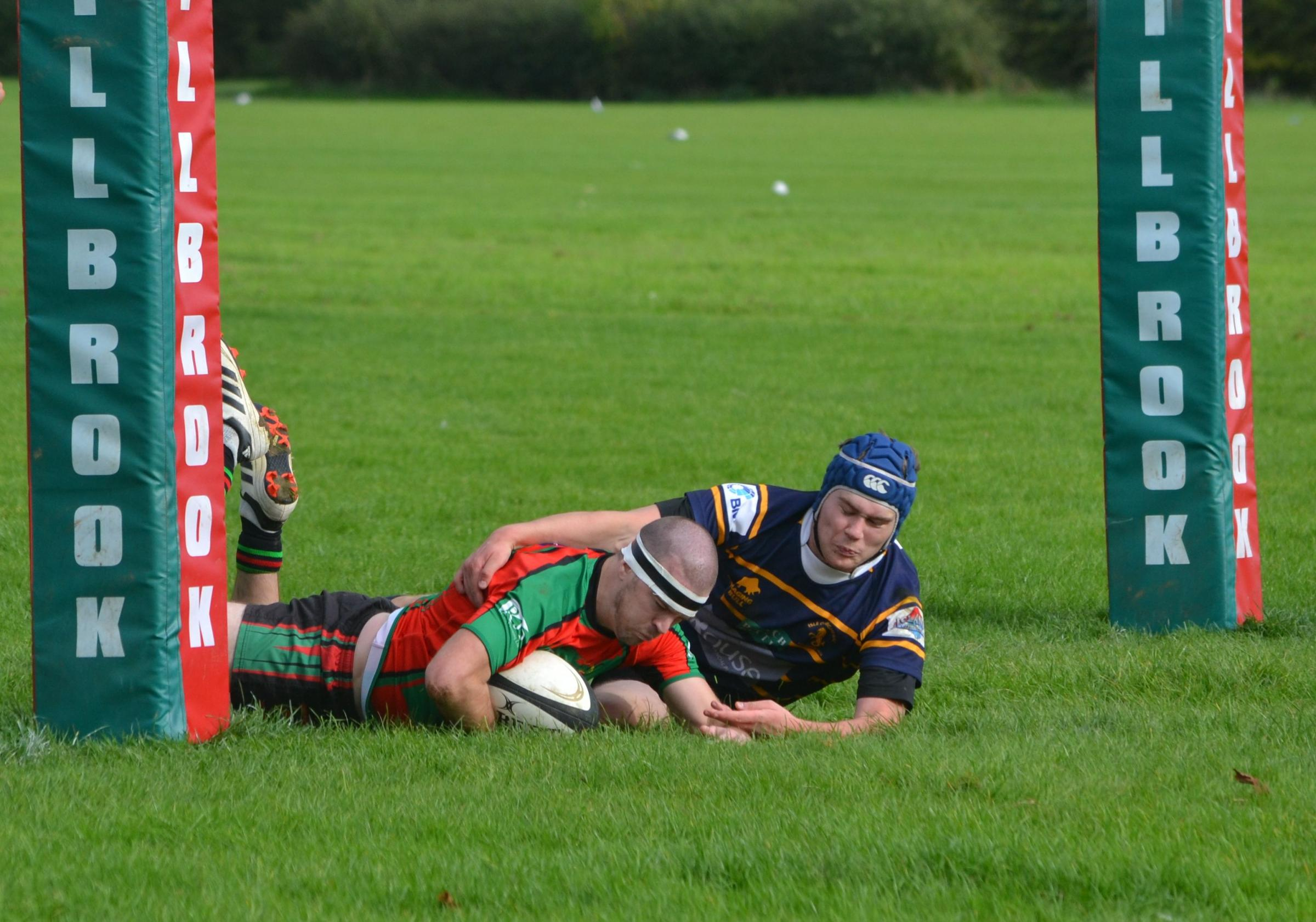 Mike McGrath goes under the posts for Millbrook. Pic: Clive Downton