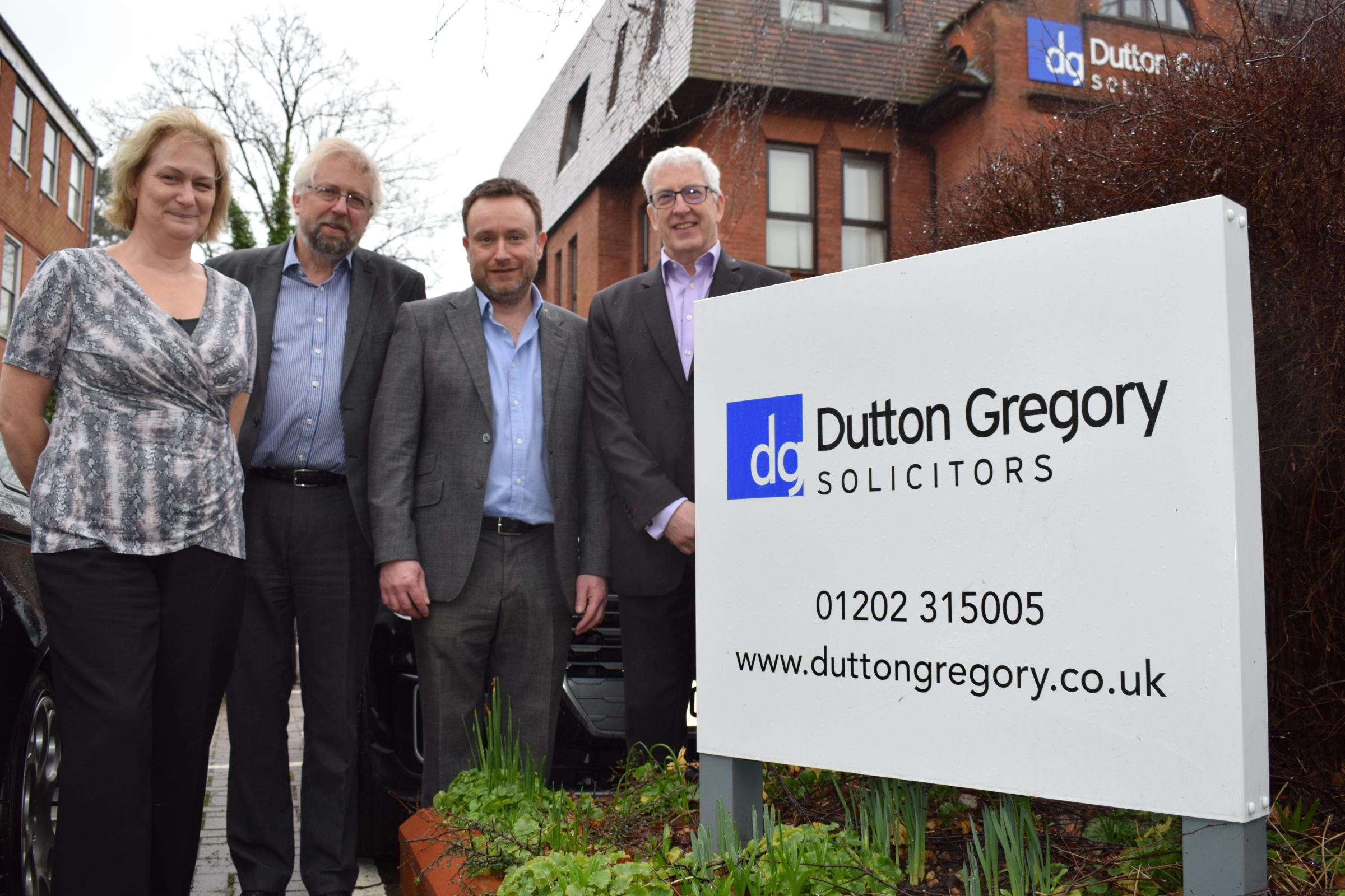 Staff from Duttons and Turners prepare for their merger in March