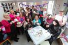 Big Tea Cosy tea party at the breast cancer Haven in Titchfield, visitors including Sally Taylor enjoy a cup of tea and a cake.