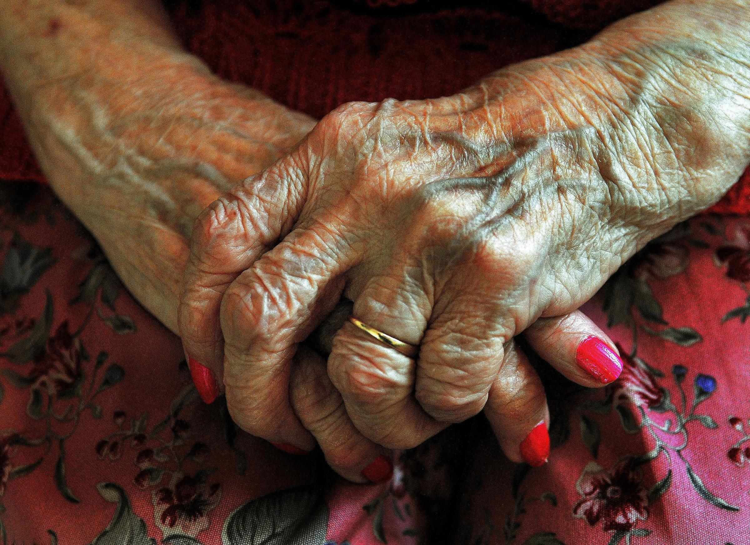 Embargoed to 0001 Monday May 21  File photo dated 05/12/08 of the hands of   an elderly woman. A report has claimed promises to bring more patient care closer to home by prioritising NHS community services have fallen flat. PRESS ASSOCIATI