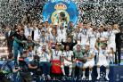 Real Madrid celebrate with the trophy (Nick Potts/PA)