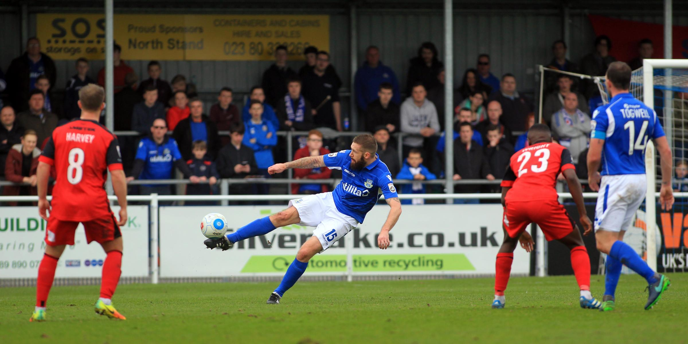 Paul Reid (centre) in action for Eastleigh