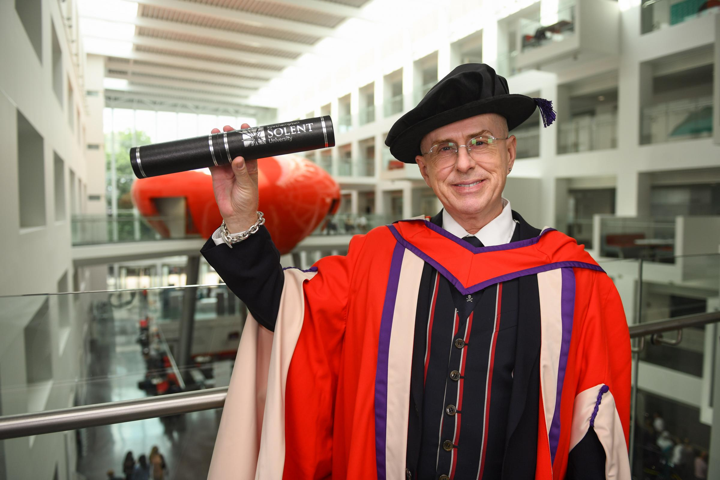 Eighties pop legend Holly Johnson  with his honorary degree from Solent University