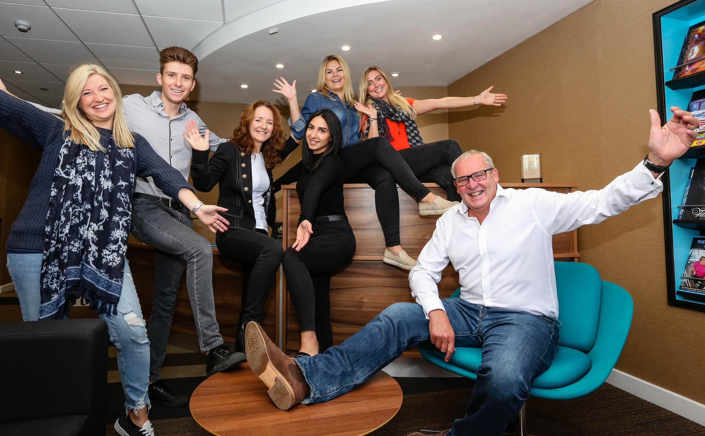 Best feet forward: Staff at Ellis Jones Solicitors, including Nigel Smith, Managing Partner (seated right), take part in this year's 'Jeans for Genes' Day.