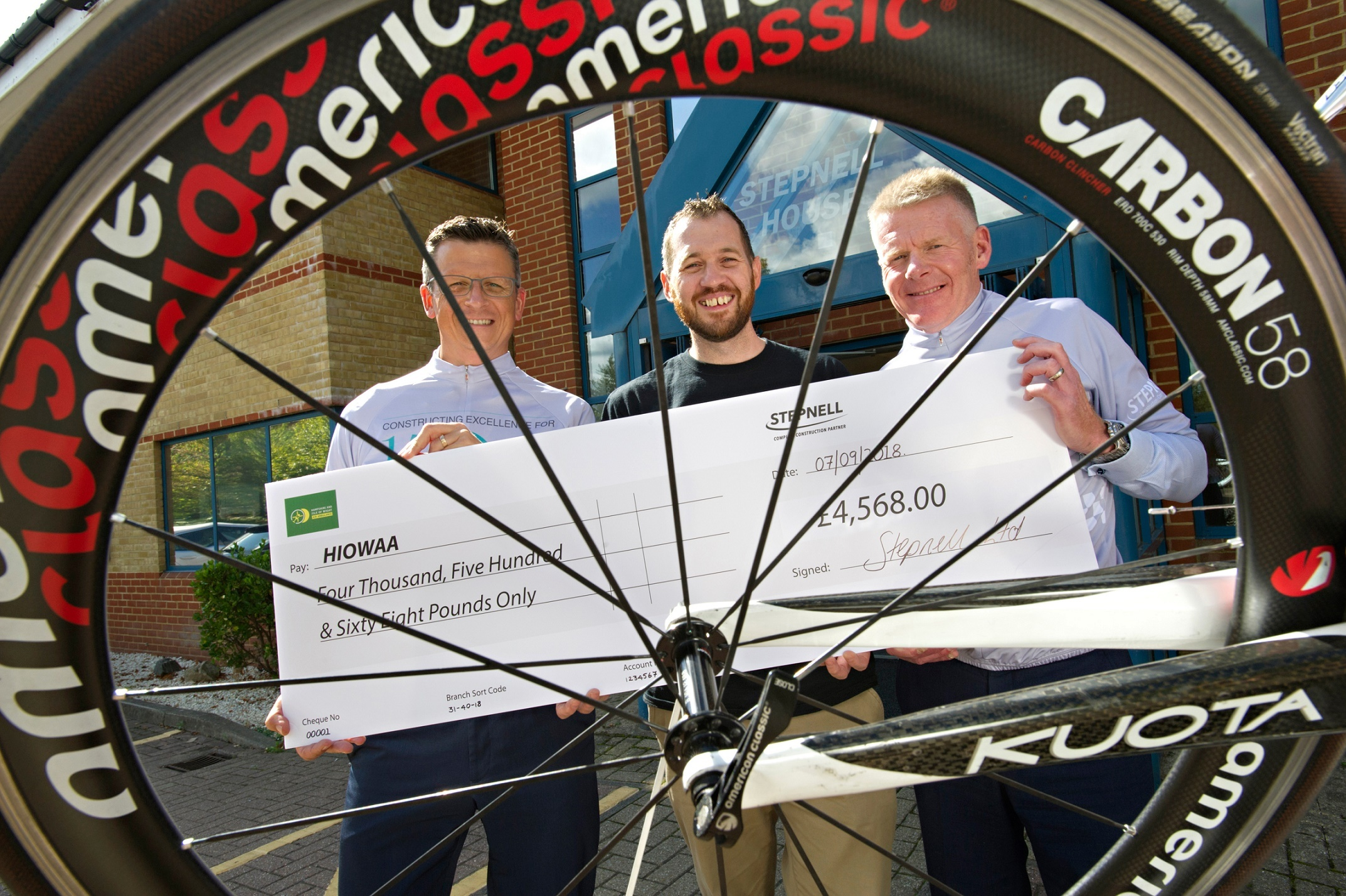 Stepnell cyclists present Hampshire and Isle of Wight Air Ambulance with a £4.5k cheque (left to right:) Matt James, Stepnell managing quantity surveyor; Ray Southam, Hampshire & Isle of Wight Air Ambulance corporate fundraiser and Nick Garlick,