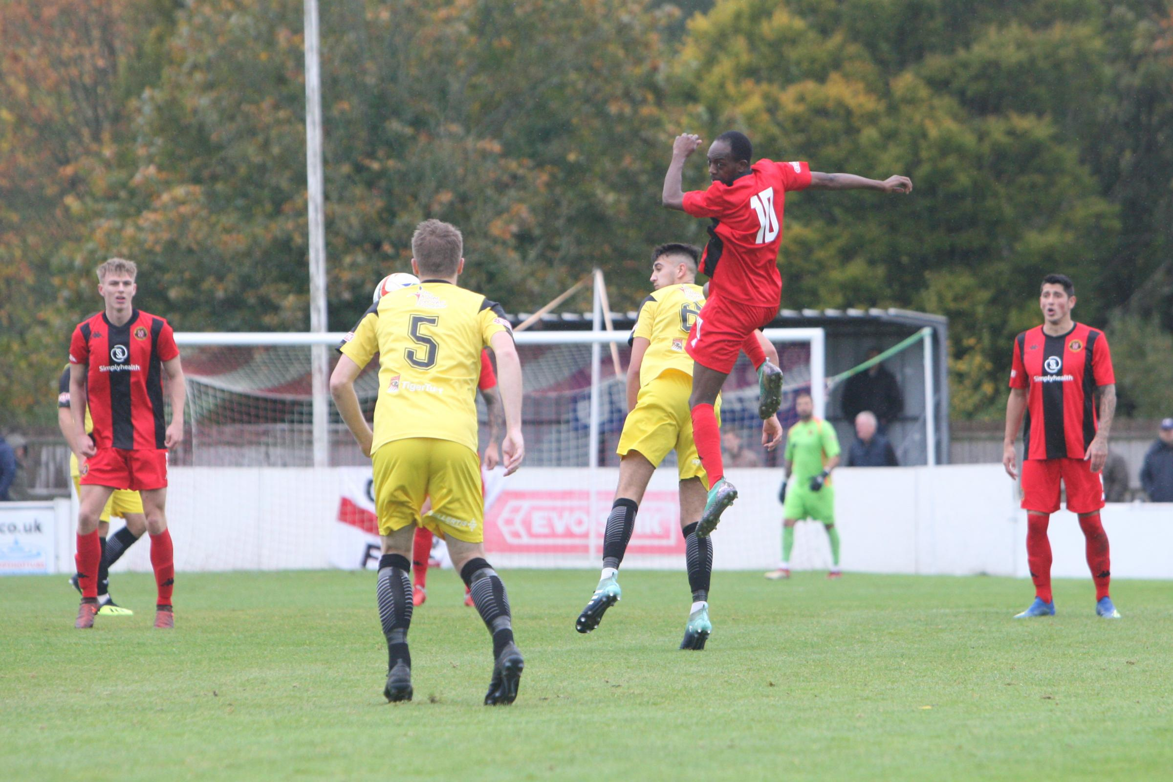 Simba Mlambo (red) in aerial action for Winchester