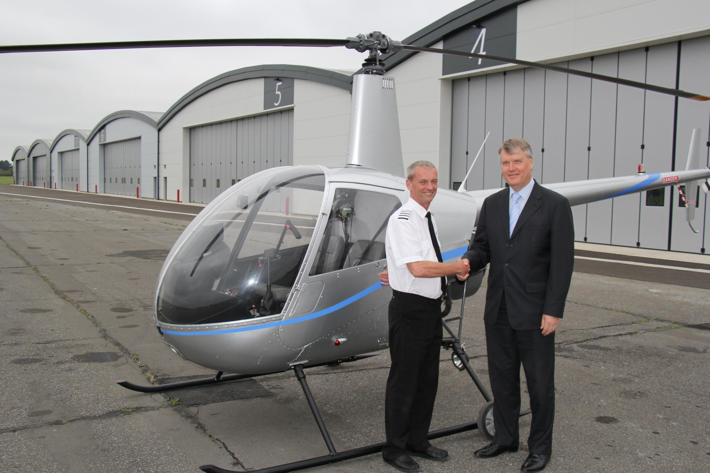 Fareham Borough Council leader Cllr Seán Woodward with Paul Andrews, Managing Director of Phoenix Helicopters, at Solent Airport at Daedalus.
