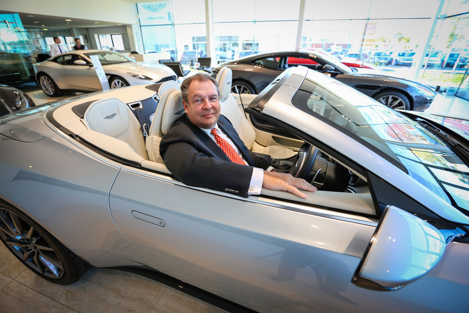 Mark Beresford at Harwoods Aston Martin dealerhsip in Chichester to promote the runner up prize for his 'Win a Mega Home' competition