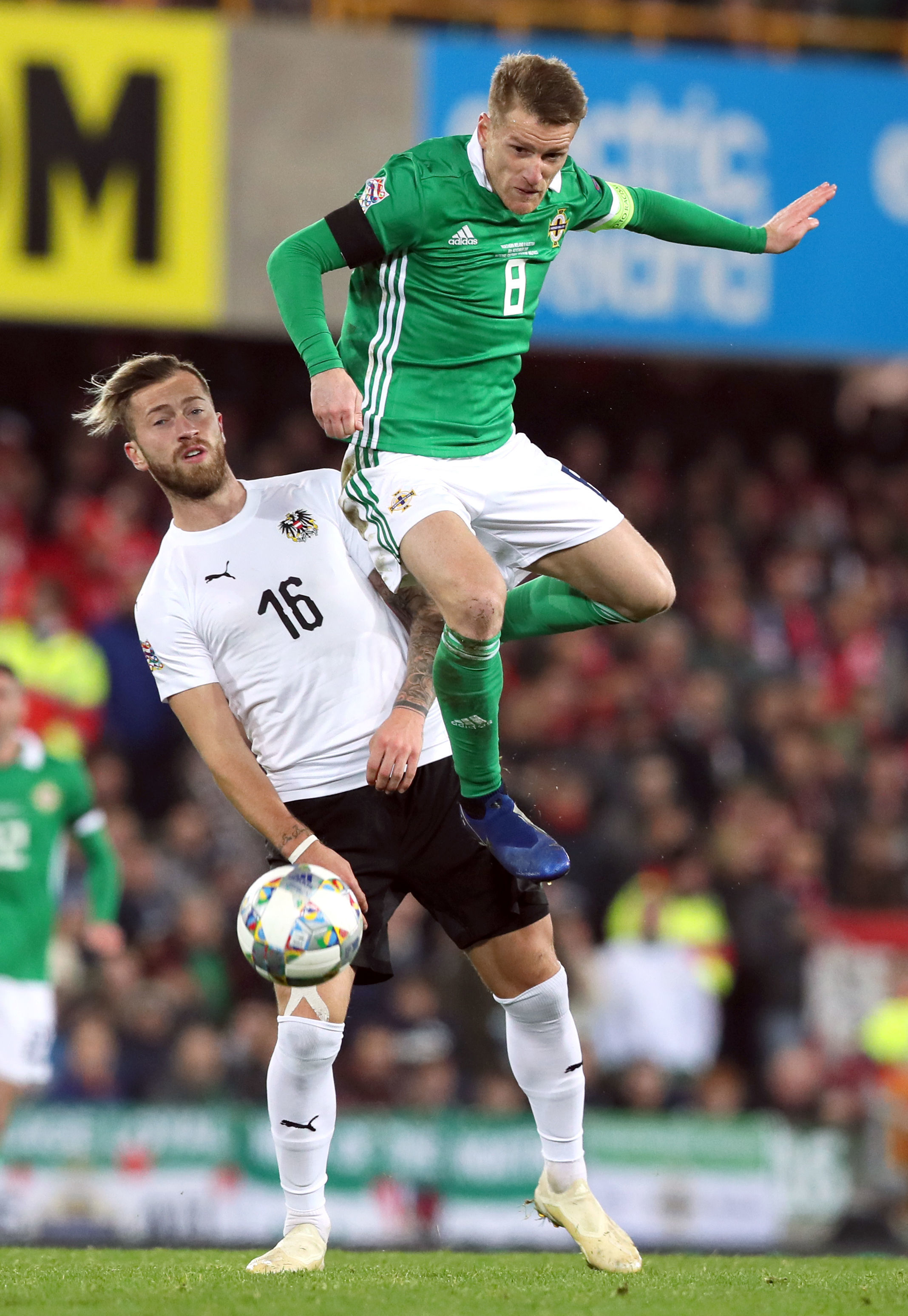 Austria's Peter Zulj (left) and Northern Ireland's Steven Davis battle for the ball during the UEFA Nations League, Group B3 match at Windsor Park, Belfast. PRESS ASSOCIATION Photo. Picture date: Sunday November 18, 2018. See PA story SOCCER N Ire