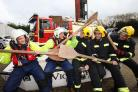 20 Dec 2015 - Photo by Stuart Martin - crews from Hamble Fire Station and Hamble Lifeboat will go headto head on New Years Day in a raft race (l-r) Brian Butcher and Paul Ackland from the lifeboat with  firefighters Pete Broomfield, Jonathan Walcroft and