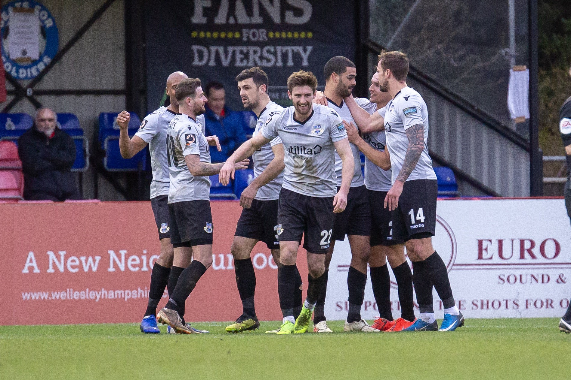Paul McCallum  (third from right) is congratulated by his Eastleigh teammates. Photo: Graham Scambler
