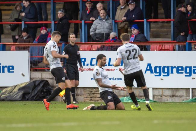 Paul McCallum slides on his knees in celebration (photo: Graham Scambler)