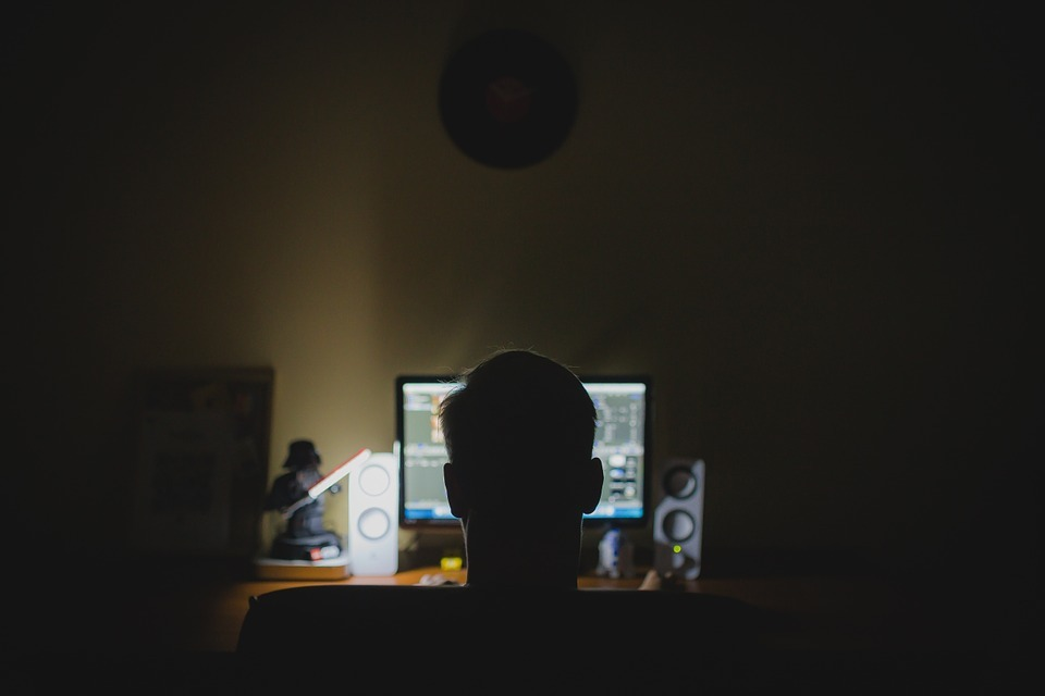 Stock image of a man at a computer