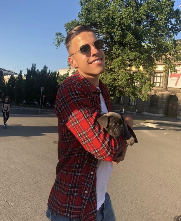 Daily Echo: Defender Jan Bednarek and his dog Candy. Photo: Instagram